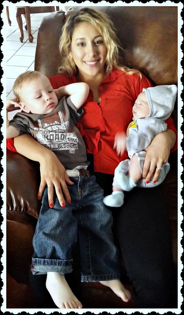 mama holding 2 kids